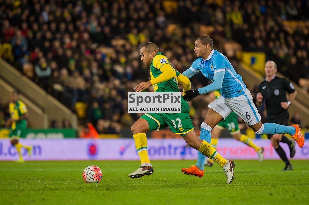 Norwich City midfielder Vadis Odjidja-Ofoe (32) escapes the clutches of Manchester City midfielder Fernando (6)