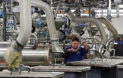 An AkzoNobel employee works at the AkzoNobel paint production facility in Sassenheim, the Netherlands, Wednesday, Dec. 22, 2010. Akzo Nobel NV, the world's biggest paint maker, reported a 21 percent increase in third quarter net income to 238 million euros. (Photo © Jock Fistick)