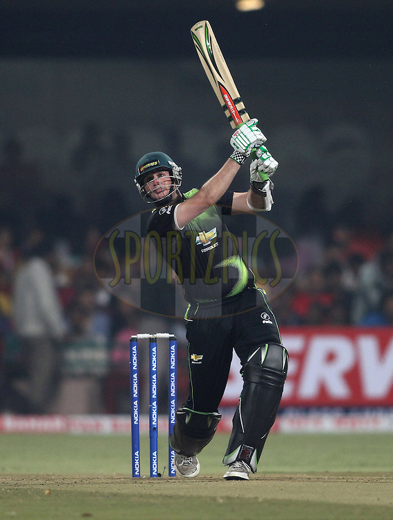 Jon-Jon Smuts of the Warriors hits over the top during match 1 of the NOKIA Champions League T20 ( CLT20 )between the Royal Challengers Bangalore and the Warriors held at the  M.Chinnaswamy Stadium in Bangalore , Karnataka, India on the 23rd September 2011..Photo by Shaun Roy/BCCI/SPORTZPICS