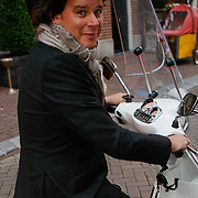 NLD/Amsterdam/20091008 - Designer Vintage for Charity party, Leco Zadelhoff op de scooter