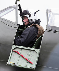 Prince Harry visits Goodwood Motor Circuit, Chichester, on behalf of the Endeavour Fund. Harry drove various cars, including an Aston Martin like his father Prince Charles\'. He also met Spitfire pilots and sat in a Spitfire. United Kingdom. Saturday, 15th February 2014. Picture by i-Images