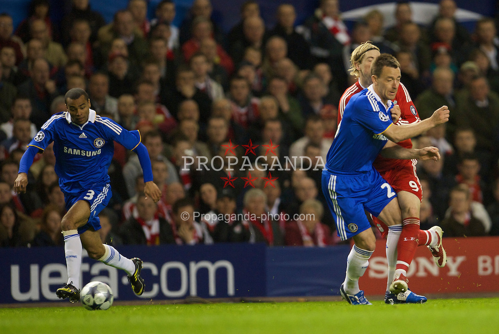 LIVERPOOL, ENGLAND - Wednesday, April 8, 2009: Liverpool's Fernando Torres is deliberately clattered into and blocked by Chelsea's cheating captain John Terry, amazingly no card was shown to Terry by the referee, during the UEFA Champions League Quarter-Final 1st Leg match at Anfield. (Photo by David Rawcliffe/Propaganda)