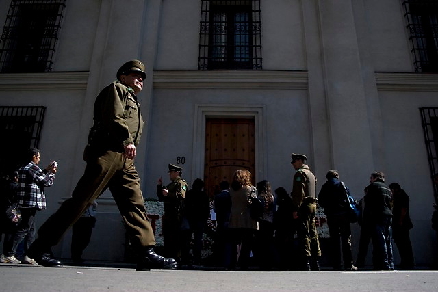 Police stand guard near Morande 80, former presidential gate, closer after the military coup 35 years after in Santiago, Thursday, Sept. 11, 2008. Chileans remember the 35th anniversary of the military coup haed by former dictator Augusto Pinochet where Allende dies.