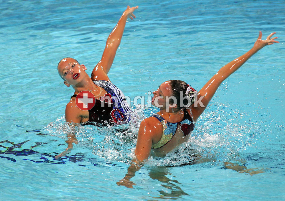 The Canadian Synchronised Swimming Team Fanny Letourneau and Courtenay Stewart perform in the women's Duet Free Routine final of the Athens 2004 Olympic Games Wednesday 25 August 2004.  (Photo by Patrick B. Kraemer / MAGICPBK)