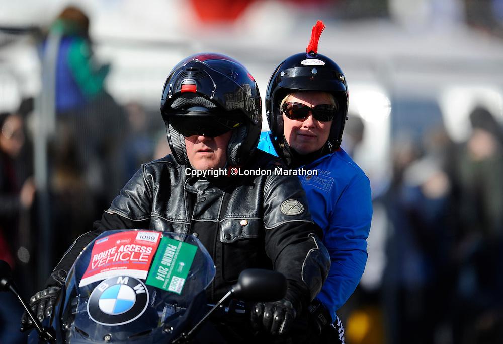 Motorbike outrider<br /> The Virgin Money London Marathon 2014<br /> 13 April 2014<br /> Photo: Javier Garcia/Virgin Money London Marathon<br /> media@london-marathon.co.uk
