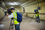 UK. London. British Telecom (BT) is selling some of its secret tunnels under the centre of London. The Kingsway Tunnels are 1 mile long and were originally built in 1940 as air raid shelters. They have been used by MI6 (Britain's secret service), the Public Records Office and BT..Photo shows foreign camera crews in one of the tunnels..Photo©Steve Forrest/Workers Photos