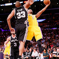 19 March 2014: Los Angeles Lakers forward Xavier Henry (7) goes for the layup against San Antonio Spurs forward Boris Diaw (33) during the San Antonio Spurs 125-109 victory over the Los Angeles Lakers at the Staples Center, Los Angeles, California, USA.