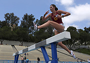 Julia Bounds hurdles a barrier in the women's steeplechase during a collegiate dual meet against UCLA at Drake Stadium in Los Angeles, Sunday, April 29, 2018.