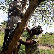 Nobel Peace Prize Winner Wangari Mathai talks to a boy in a village outside of Juba, South Sudan.