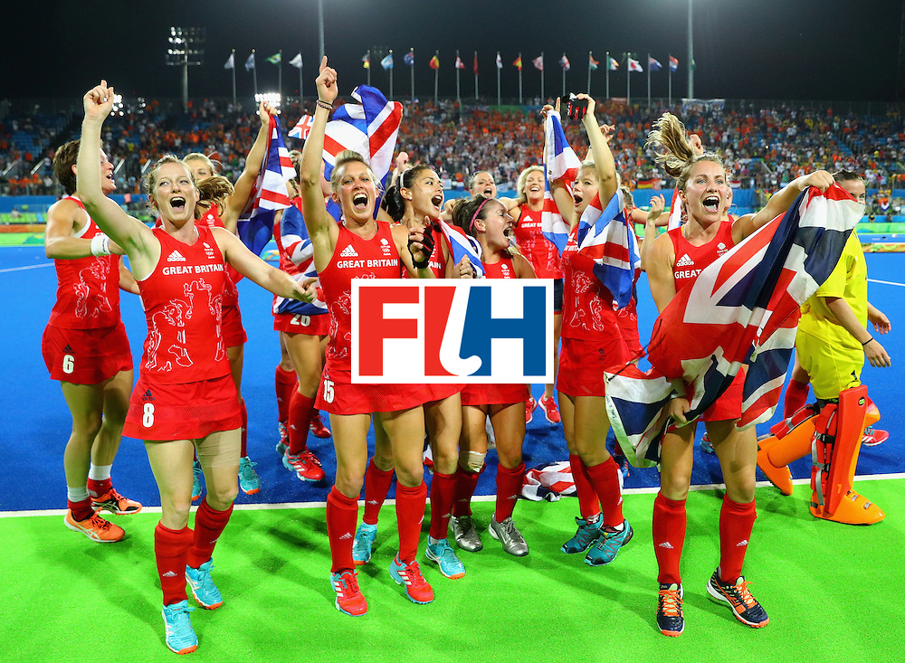 RIO DE JANEIRO, BRAZIL - AUGUST 19:  Team Great Britain celebrate after defeating Netherlands in the Women's Gold Medal Match on Day 14 of the Rio 2016 Olympic Games at the Olympic Hockey Centre on August 19, 2016 in Rio de Janeiro, Brazil.  (Photo by Tom Pennington/Getty Images)