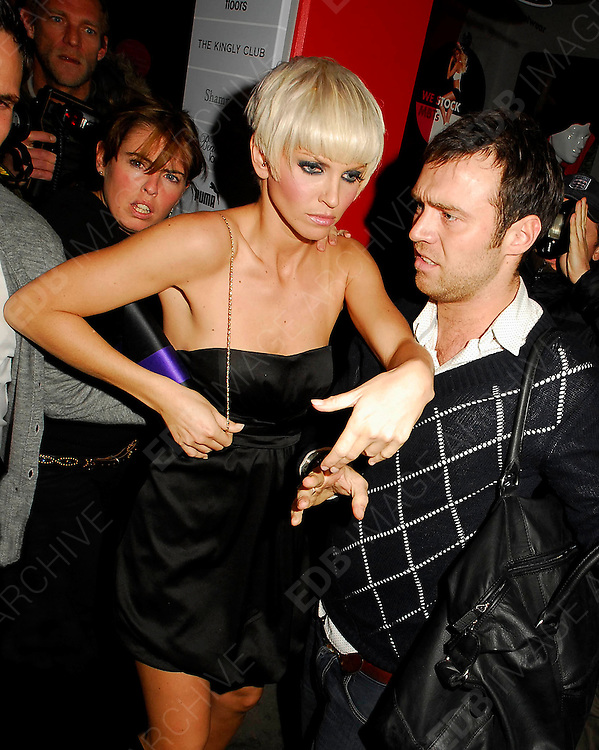 17.10.2007. LONDON<br /> <br /> SARAH HARDING AND BOYFRIEND DJ TOM CRANE LOOKING A LITTLE WORSE FOR WEAR LEAVING THE KINGLY NIGHT CLUB IN SOHO, LONDON, UK.<br /> <br /> BYLINE: EDBIMAGEARCHIVE.CO.UK<br /> <br /> *THIS IMAGE IS STRICTLY FOR UK NEWSPAPERS AND MAGAZINES ONLY*<br /> *FOR WORLD WIDE SALES AND WEB USE PLEASE CONTACT EDBIMAGEARCHIVE - 0208 954 5968*