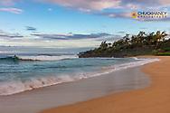 Surfer at Paliku aka Donkey Beach in Kealia in Kauai, Hawaii, USA