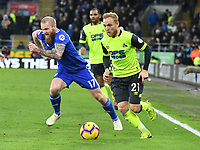 Football - 2018 / 2019 Premier League - Cardiff City vs. Huddersfield Town<br /> <br /> Alex Pritchard of Huddersfield Town beats Aron Gunnarsson Cardiff City, at the Cardiff City Stadium.<br /> <br /> COLORSPORT/WINSTON BYNORTH