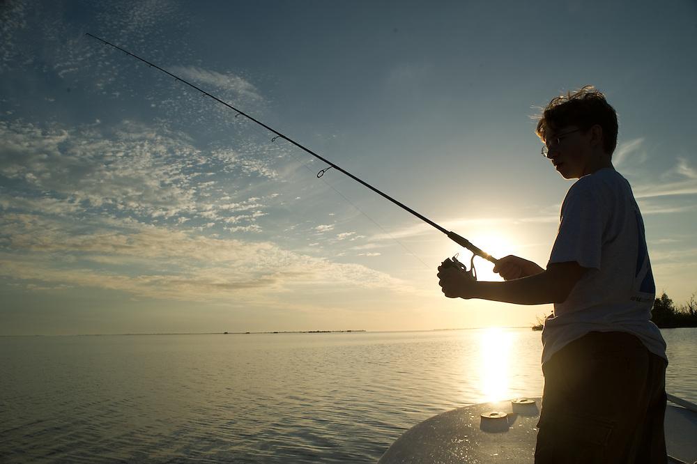 Teenager fishing,  Pine Island Florida