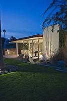Modern house exterior illuminated at dusk