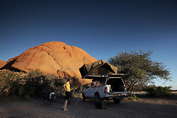 NAMIBIA DAMARALAND 25APR14 - <br /> Camping at the Spitzkoppe Nature Reserve, Damaraland, Namibia.<br /> <br /> <br /> The granite is more than 700 million years old and the highest outcrop rises about 1,784 metres above sea level. The peaks stand out dramatically from the flat surrounding plains, with the highest peak reaching about 700 m  above the floor of the desert below.<br /> <br /> jre/Photo by Jiri Rezac<br /> <br /> <br /> <br /> © Jiri Rezac 2014