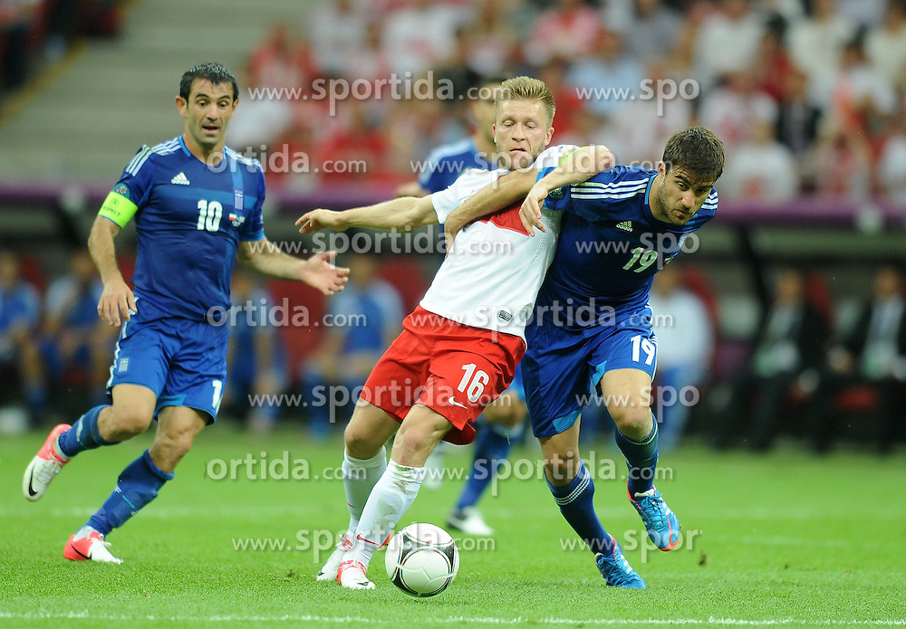 08.06.2012, Nationalstadion, Warschau, POL, UEFA EURO 2012, Polen vs Griechenland, Gruppe A, im Bild JAKUB BLASZCZYKOWSKI SOKRATIS PAPASTATHOPOULOS // during the UEFA Euro 2012 Group A Match between Poland and Greece at the National Stadium Warsaw, Poland on 2012/06/08. EXPA Pictures © 2012, PhotoCredit: EXPA/ Newspix/ Lukasz Laskowski..***** ATTENTION - for AUT, SLO, CRO, SRB, SUI and SWE only *****