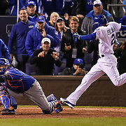 Kansas City Royals shortstop Alcides Escobar scored the winning run in the 14th inning past New York Mets catcher Travis d'Arnaud in Game 1 of the 2015 World Series on October 28, 2015 at Kauffman Stadium in Kansas City, Mo.