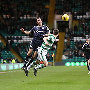 Dundee&rsquo;s Cammy Kerr oujumps Celtic's Kieran Tierney - Celtic v Dundee - Ladbrokes Scottish Premiership at Dens Park<br /> <br />  - &copy; David Young - www.davidyoungphoto.co.uk - email: davidyoungphoto@gmail.com