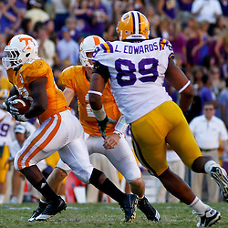 Oct 2, 2010; Baton Rouge, LA, USA; LSU Tigers defensive end Lavar Edwards (89) pursues Tennessee Volunteers running back Tauren Poole (28) during the second half at Tiger Stadium. LSU defeated Tennessee 16-14.  Mandatory Credit: Derick E. Hingle