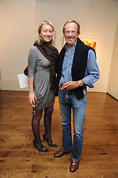 JOSIE GOODBODY and TONY LONSDALE at an exhibition of Tahnee Lonsdale's paintings held at The Commander, 47 Hereford Road, London on 8th October 2008.
