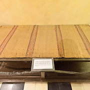 A rudimentary bed on display as an example in the exhibit's case that the American pilots held at the prison during the war were well treated. Hoa Lo Prison, also known sarcastically as the Hanoi Hilton during the Vietnam War, was originally a French colonial prison for political prisoners and then a North Vietnamese prison for prisoners of war. It is especially famous for being the jail used for American pilots shot down during the Vietnam War.