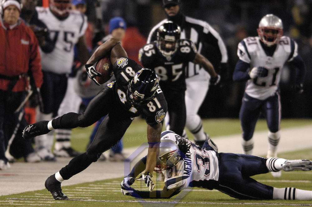 Baltimore Ravens wide receiver Devard Darling (81) catches a 52-yard pass in the 1st quarter against New England Patriots safety Brandon Meriweather (31) on December 3, 2007 at M&T Bank Stadium in Baltimore, Maryland.  The Patriots defeated the Ravens 27-24.
