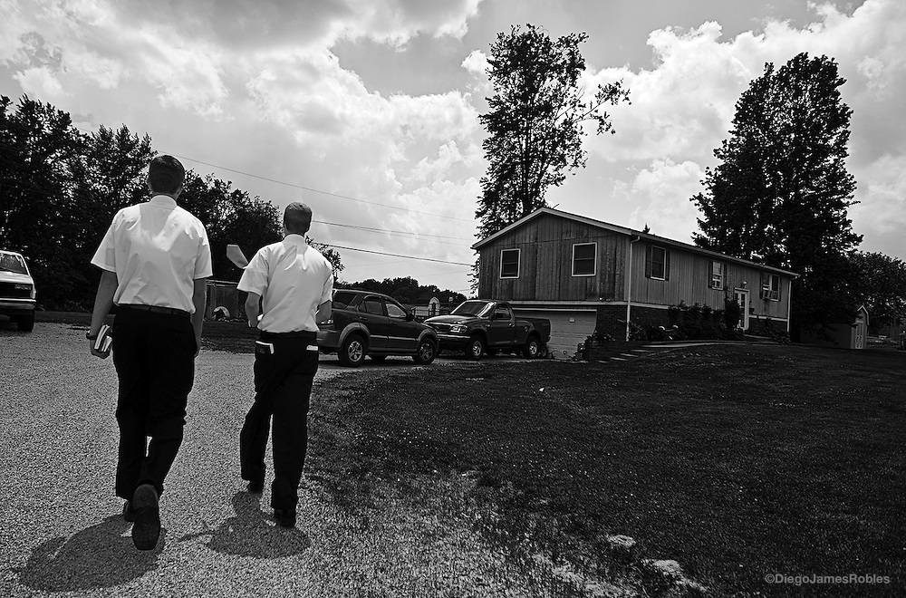 While conducting cold calls all afternoon, from right, Elder Barker and Elder Balls walk up to a house in The Plains, Ohio, on Saturday, May 31, 2008.