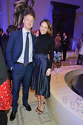 LAVINIA BRENNAN and JAMIE RICHARDS at a private view of Alexander McQueen's Savage Beauty exhibition hosted by Samsung BlueHouse at the V&A, London on 30th March 2015.