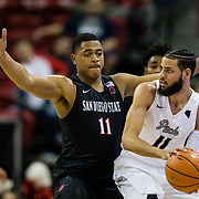 09 March 2018: San Diego State men's basketball takes on Nevada in the quarterfinal round of the Mountain West Conference Tournament. San Diego State Aztecs forward Matt Mitchell (11) sticks to the hip of Nevada Wolf Pack forward Cody Martin (11) as he looks to pass the ball in the first half. The Aztecs cruise past the Wolfpack 90-73 to move on to the Championship game tomorrow afternoon at 3pm.<br /> More game action at www.sdsuaztecphotos.com