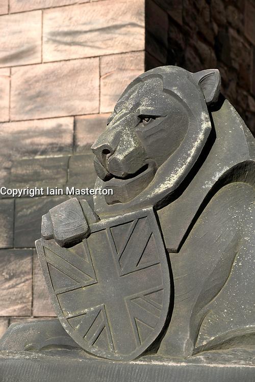 Statue of Lion with shield outside Scottish National War Memorial inside Edinburgh Castle, Scotland, United Kingdom