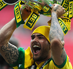 Norwich City's Bradley Johnson lifts the trophy as Norwich City win promotion to the premier league   - Photo mandatory by-line: Joe Meredith/JMP - Mobile: 07966 386802 - 25/05/2015 - SPORT - Football - London - Wembley Stadium - Middlesbrough v Norwich - Sky Bet Championship - Play-Off Final