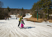 Andi and her daughter Harper visiting from Rye, NH take a run on the Penny Pitou Quad Thursday afternoon at Gunstock.  (Karen Bobotas/for the Laconia Daily Sun)