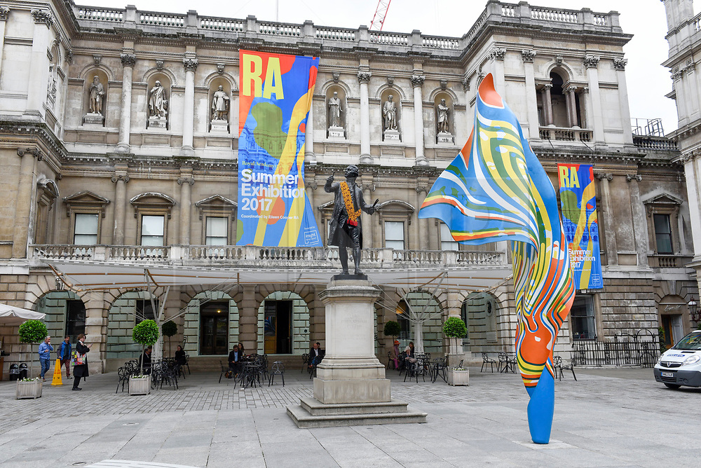 """© Licensed to London News Pictures. 08/06/2017. London, UK. A 6m high sculpture caled """"Wind Sculpture VI"""" by Yinka Shonibare RA greets visitors to the Summer Exhibition 2017 at the Royal Academy of Arts in Piccadilly.  Co-ordinated by Royal Academician Eileen Cooper, the 249th Summer Exhibition is the world's largest open submission exhibition with around 1,100 works on display by high profile and up and coming artists.<br />  Photo credit : Stephen Chung/LNP"""