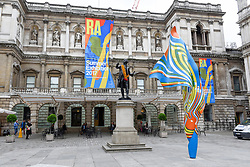 &copy; Licensed to London News Pictures. 08/06/2017. London, UK. A 6m high sculpture caled &quot;Wind Sculpture VI&quot; by Yinka Shonibare RA greets visitors to the Summer Exhibition 2017 at the Royal Academy of Arts in Piccadilly.  Co-ordinated by Royal Academician Eileen Cooper, the 249th Summer Exhibition is the world's largest open submission exhibition with around 1,100 works on display by high profile and up and coming artists.<br />  Photo credit : Stephen Chung/LNP