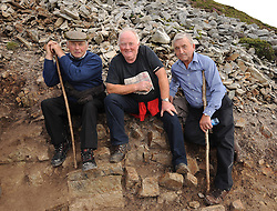 Men on the mountain….. Padraig McHale, Tom Prendergast Ballintubber and Michael Hastings pictured on their way up Croagh Patrick during the annual pilgrimage on sunday last. <br />
