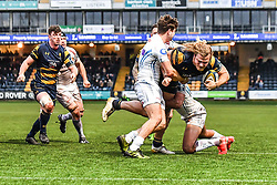David Denton of Worcester Warriors is tackled by Tom Hendrickson and Tom O'Flaherty of Exeter Chiefs - Mandatory by-line: Craig Thomas/JMP - 27/01/2018 - RUGBY - Sixways Stadium - Worcester, England - Worcester Warriors v Exeter Chiefs - Anglo Welsh Cup