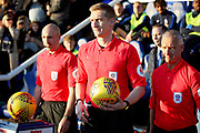Referee S Oldham and his team lead the teams out before the EFL Sky Bet League 1 match between Peterborough United and Bradford City at The Abax Stadium, Peterborough, England on 17 November 2018.