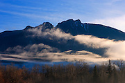 Fog lifts from the Snoqualmie Valley, somewhat mimicking the shape of Mount Si, a prominent 4,167 ft (1,270 m) peak located in North Bend, Washington.