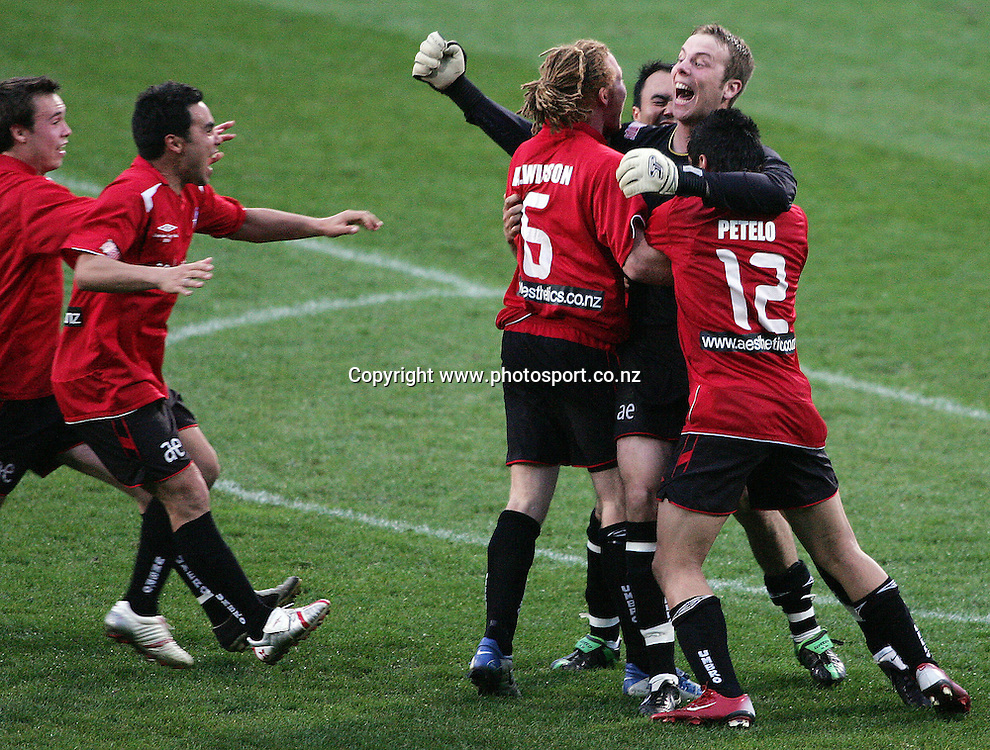 Western Suburbs celebrate with goal keeper Phil Imray after he saved a penalty shot from Eastern Suburbs during the Chatham Cup soccer final between Western Suburbs and Eastern Suburbs at North Harbour Stadium, Auckland, New Zealand on Saturday 2 September, 2006. Western Suburbs won the match after extra time and a penalty shoot out. Photo: Hannah Johnston/PHOTOSPORT<br /> <br /> <br /> <br /> <br /> 020906