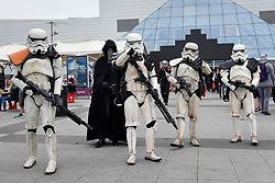 © Licensed to London News Pictures. 28/05/2017. London, UK. Stormtroopers from Star Wars at MCM Comic Con taking place at Excel in East London.  The three day event celebrates popular comic books, anime, games, television and movies.  Many attendees take the opportunity to dress as their favourite characters.    Photo credit : Stephen Chung/LNP
