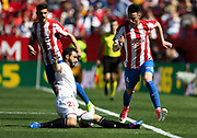 Burgui of Sporting Gijon is tackled by Nico Pareja of Sevilla FC during the Spanish championship Liga football match between Sevilla FC and Sporting Gijon on April 2, 2017 at Sanchez Pizjuan stadium in Sevilla, Spain - photo Cristobal Duenas / Spain / ProSportsImages / DPPI