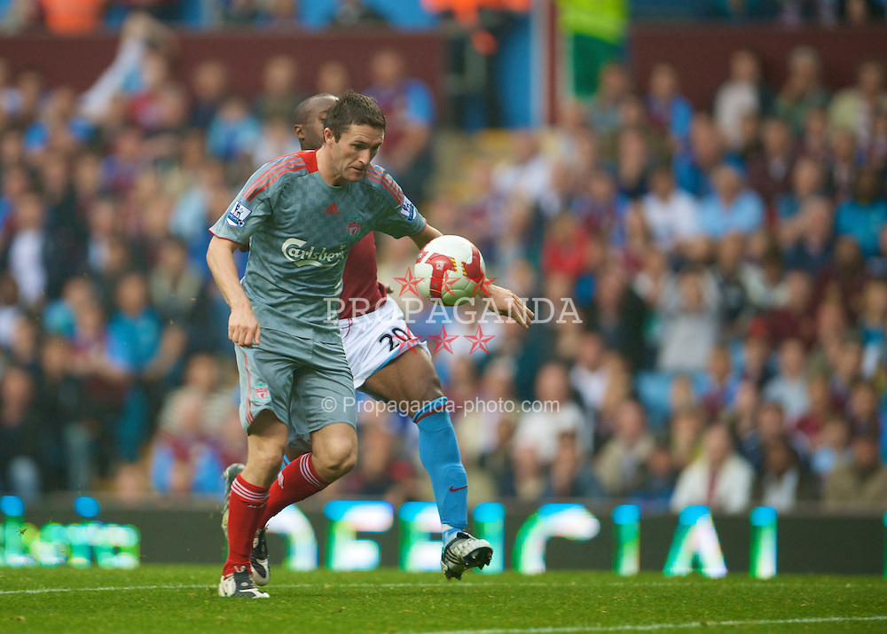 BIRMINGHAM, ENGLAND - Sunday, August 31, 2008: Liverpool's Robbie Keane is twarted by Aston Villa's Curtis Davies as he runs through on goal during the Premiership match at Villa Park. (Photo by David Rawcliffe/Propaganda)