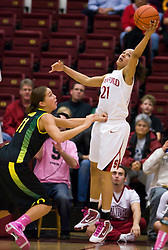 February 18, 2010; Stanford, CA, USA;  Stanford Cardinal guard Rosalyn Gold-Onwude (21) grabs a rebound from Oregon Ducks forward Amanda Johnson (11) during the first half at Maples Pavilion.  Stanford defeated Oregon 104-60.