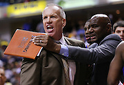 April 21, 2012; Indianapolis, IN, USA; Philadelphia 76ers head coach Doug Collins yells at a referee as he walks off the court following the game against the Indiana Pacers at Bankers Life Fieldhouse. Philadelphia defeated Indiana 109-106. Mandatory credit: Michael Hickey-US PRESSWIRE