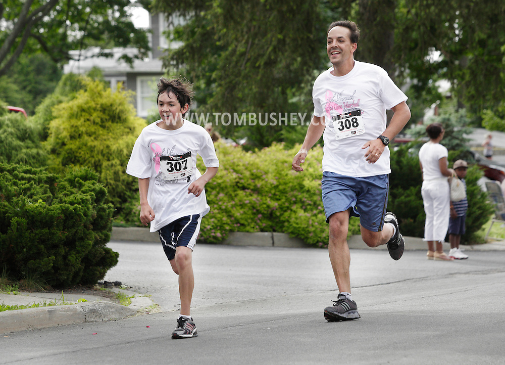 Middletown, New York - Vinnie Leo, left, and Ed Leo of Middletown head for the finish line in the 15th annual Ruthie Dino Marshall 5K Run and Fun Walk hosted by the Middletown YMCA on Sunday, June 5, 2011. Both Leos finished in 26:31.