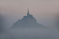 Mont St. Michel rising out of the mists at dawn as if it's appearing from another world.