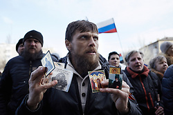 © Licensed to London News Pictures. 08/03/2014. Ukraine. A protestor at a demonstration in Donetsk, Ukraine, involving groups of pro-Russia and anti-Putin protestors, in the wake of events in Kyiv. .  Photo credit : Christopher Nunn/LNP