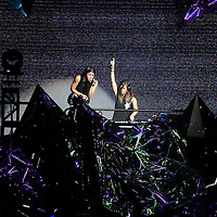 "Sisters Yasmine and Jahan Yousaf of the band Krewella perform in front of the ""Light Volcano"", during the Verge Campus Spring Tour concert at the CFE Arena on the University of Central Florida campus, Tuesday, April 8, 2014, in Orlando, Florida.  (AP Photo/Alex Menendez)"