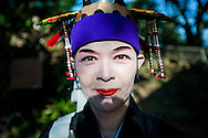 Local performer at the Dansaa Matsuri (Festival) in Uehara on the remote island of Iriomote.  Iriomote Island, Okinawa, Japan.